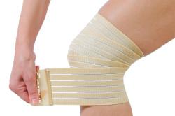 Перевязка колена при растяжении